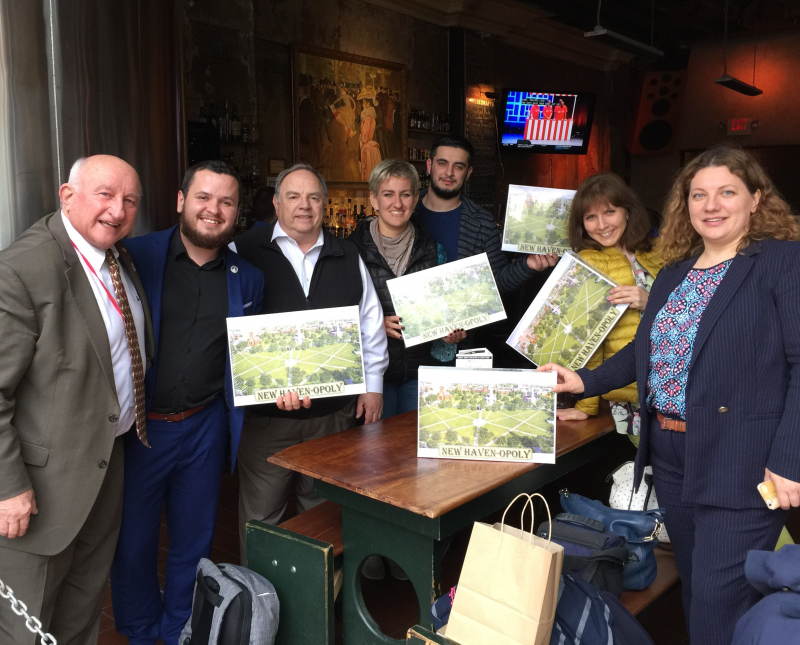 The visiting Russian delegation shows off their New Haven Rotaropoly games!